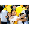 Happy students hugging and holding giraffe ballons - Orientation Week, c. 2011